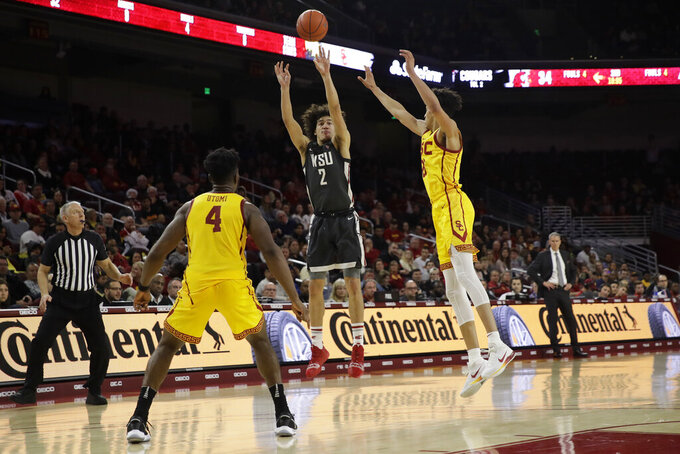 Washington State's CJ Elleby, center, shoots against Southern California during the second half of an NCAA college basketball game Saturday, Feb. 15, 2020, in Los Angeles. (AP Photo/Marcio Jose Sanchez)