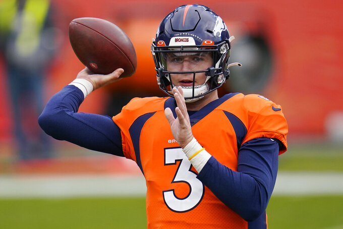 Denver Broncos quarterback Drew Lock (3) warms up before an NFL football game against the Las Vegas Raiders, Sunday, Jan. 3, 2021, in Denver. (AP Photo/Jack Dempsey)