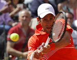 Serbia's Novak Djokovic returns the ball to Canada's Denis Shapovalov at the Italian Open tennis tournament, in Rome, Thursday, May, 16, 2019. (AP Photo/Alessandra Tarantino)