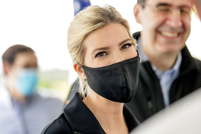 Ivanka Trump, the daughter of President Donald Trump, wears a mask as she speaks with employees following a tour of Coastal Sunbelt Produce, Friday, May 15, 2020, in Laurel, Md. (AP Photo/Andrew Harnik)