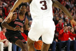 orgia's Anthony Edwards (5) looks to get past Texas A&M guard Quenton Jackson (3) during an NCAA basketball game in Athens, Ga., on Saturday, Feb. 1, 2020. (Joshua L. Jones/Athens Banner-Herald via AP)
