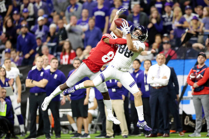 Ohio State cornerback Kendall Sheffield, left, breaks up a pass intended for Northwestern wide receiver Bennett Skowronek (88) during the second half of the Big Ten championship NCAA college football game, Saturday, Dec. 1, 2018, in Indianapolis. Ohio State won 45-24. (AP Photo/AJ Mast)