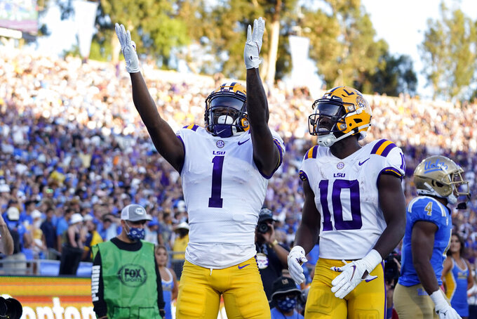 LSU wide receiver Kayshon Boutte (1) celebrates his touchdown catch with wide receiver Jaray Jenkins (10) during the first half of the team's NCAA college football game against UCLA on Saturday, Sept. 4, 2021, in Pasadena, Calif. (AP Photo/Marcio Jose Sanchez)