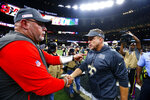 New Orleans Saints head coach Sean Payton, right, greets Tampa Bay Buccaneers head coach Bruce Arians after an NFL football game in New Orleans, Sunday, Oct. 6, 2019. The Saints won 31-24. (AP Photo/Butch Dill)