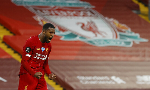 Liverpool's Georginio Wijnaldum, right turns and celebrates after scoring his sides 3rd goal during the English Premier League soccer match between Liverpool and Chelsea at Anfield Stadium in Liverpool, England, Wednesday, July 22, 2020. (Phil Noble/Pool via AP)