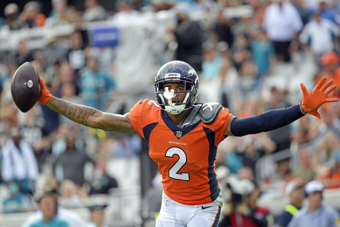 Denver Broncos cornerback Pat Surtain II celebrates after intercepting a Jacksonville Jaguars pass during the second half of an NFL football game, Sunday, Sept. 19, 2021, in Jacksonville, Fla. (AP Photo/Phelan M. Ebenhack)