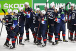 United States players celebrate their 6-1 victory during the Ice Hockey World Championship quarterfinal match between the United States and Slovakia at the Arena in Riga, Latvia, Thursday, June 3, 2021.(AP Photo/Sergei Grits)