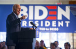 Democratic presidential candidate former Vice President Joe Biden speaks to local residents during a bus tour stop, Friday, Dec. 6, 2019, in Cedar Rapids, Iowa. (Andy Abeyta/The Gazette via AP)
