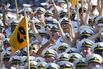 Navy Midshipmen celebrate a second quarter Navy touchdown during an NCAA college football game against Holy Cross, Saturday, Aug. 31, 2019, in Annapolis, Md. (Paul W. Gillespie/Capital Gazette via AP)