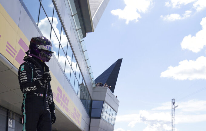 Mercedes driver Lewis Hamilton of Britain celebrates after he clocked the fastest time during the qualifying session for the British Formula One Grand Prix at the Silverstone racetrack, Silverstone, England, Saturday, Aug. 1, 2020. The British Formula One Grand Prix will be held on Sunday. (Will Oliver/Poolvia AP)