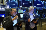 Traders Sal Suarino, left, and Frank O'Connell work on the floor of the New York Stock Exchange, Tuesday, July 20, 2021. Stocks are opening higher on Wall Street Tuesday as investors shake off a rout a day earlier brought on by concerns about the spread of a more contagious variant of COVID-19. (AP Photo/Richard Drew)