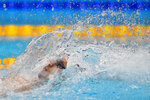 Evgeny Rylov, of Russian Olympic Committee, competes in the men's 200-meter backstroke final at the 2020 Summer Olympics, Friday, July 30, 2021, in Tokyo, Japan. (AP Photo/Jae C. Hong)