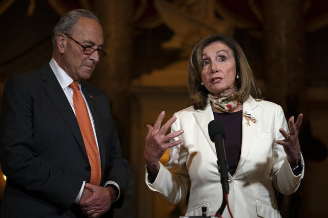 House Speaker Nancy Pelosi of Calif., and Senate Minority Leader Sen. Chuck Schumer of N.Y., speak to reporters on Capitol Hill in Washington, Thursday, Aug. 6, 2020. (AP Photo/Carolyn Kaster)