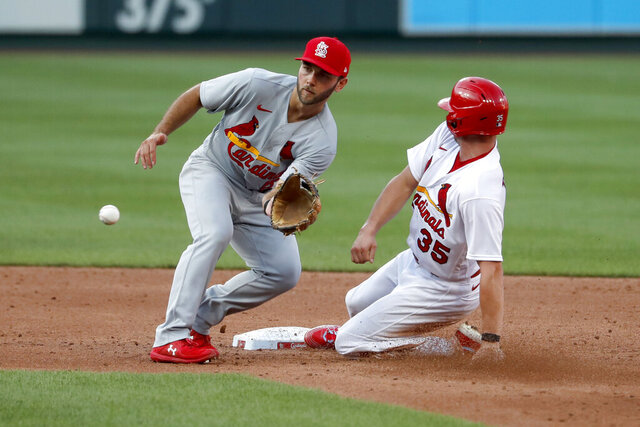 St. Louis Cardinals' Lane Thomas (35) is safe at second for a stolen base as infielder Max Schrock handles the throw during an intrasquad practice baseball game at Busch Stadium Thursday, July 9, 2020, in St. Louis. (AP Photo/Jeff Roberson)