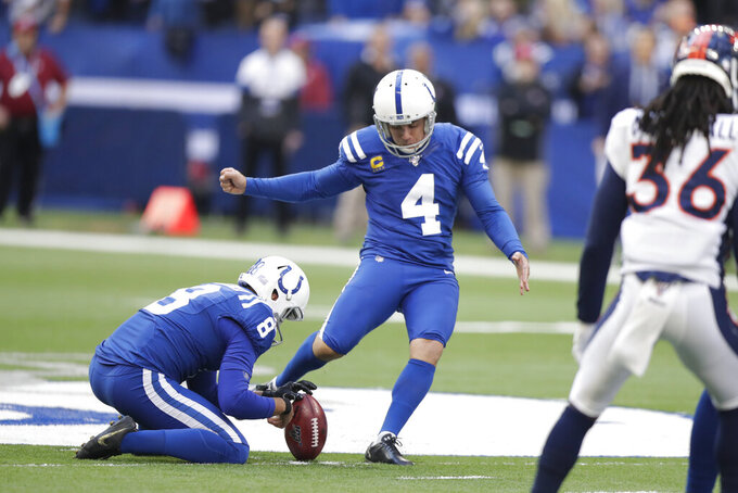 Indianapolis Colts kicker Adam Vinatieri (4) kicks a field goal out of the hold of Rigoberto Sanchez (8) during the first half of an NFL football game against the Denver Broncos, Sunday, Oct. 27, 2019, in Indianapolis. (AP Photo/Michael Conroy)