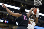 Minnesota's Daniel Oturu (25) takes a shot against Penn State's Lamar Stevens (11) during the first half of an NCAA college basketball game in the second round of the Big Ten Conference tournament, Thursday, March 14, 2019, in Chicago. (AP Photo/Kiichiro Sato)