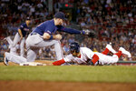 Boston Red Sox's Mookie Betts dives back to first base on a pickoff attempt, next to Minnesota Twins first baseman C.J. Cron during the fourth inning of a baseball game Wednesday, Sept. 4, 2019, in Boston. (AP Photo/Mary Schwalm)