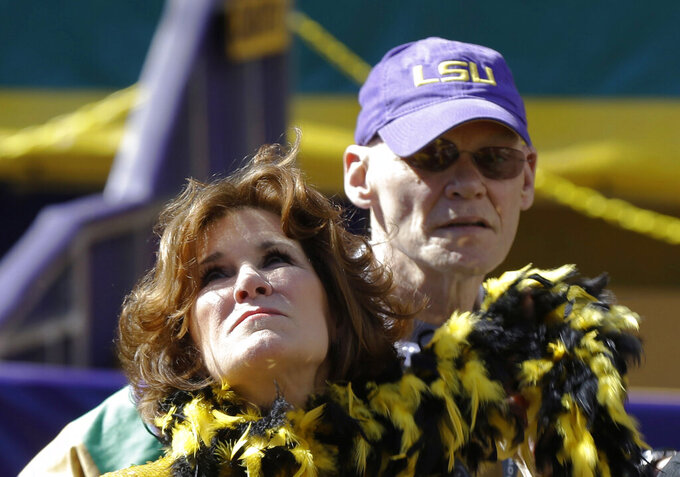 FILE - This Feb. 3, 2013, file photo shows political pundits and New Orleans Super Bowl Host Committee Co-Chairs Mary Matalin left, and James Carville in New Orleans. The couple  have replaced the New Orleans mansion that they sold for $3.3 million with a condo. Carville tells The Times-Picayune / The New Orleans Advocate that they like the fact that it's on one floor and is less than half the size of their former house. (AP Photo/Gerald Herbert, File)