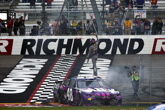 Alex Bowman (48) stands on his car as he celebrates after winning a NASCAR Cup Series auto race at Richmond International Raceway in Richmond, Va., Sunday, April 18, 2021. (AP Photo/Steve Helber)