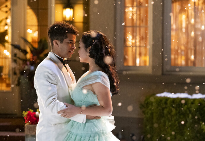In this undated image provided by Netflix is Lana Condor, right, and Jordan Fisher in a scene from the film,