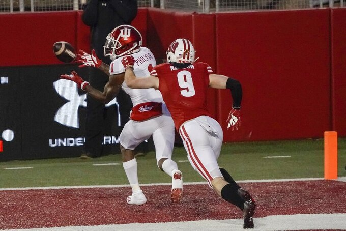 Indiana's Whop Philyor catches a touchdown pass in front of Wisconsin's Scott Nelson during the second half of an NCAA college football game Saturday, Dec. 5, 2020, in Madison, Wis. (AP Photo/Morry Gash)