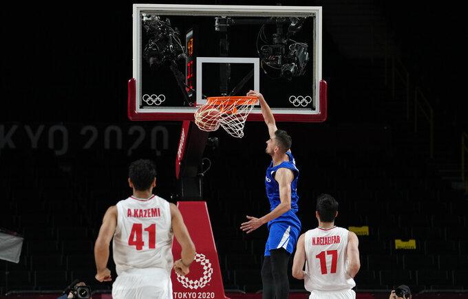 Czech Republic's Tomas Satoransky, center, shoots the ball during men's basketball game against Iran at the 2020 Summer Olympics, Sunday, July 25, 2021, in Saitama, Japan. (AP Photo/Eric Gay)