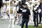 New Orleans Saints head coach Sean Payton, right, speak with quarterback Drew Brees (9) during the first half of an NFL football game, Monday, Sept. 21, 2020, in Las Vegas. (AP Photo/Isaac Brekken)
