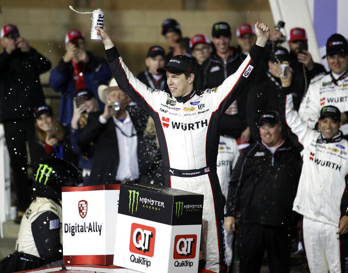 Brad Keselowski celebrates in Victory Lane following the NASCAR Cup Series auto race at Kansas Speedway in Kansas City, Kan., Saturday, May 11, 2019. (AP Photo/Orlin Wagner)