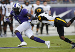 TCU's Jalen Reagor (1) is tackled by Aransas-Pine Bluff's Taeyler Porter during the first half of an NCAA college football game Saturday, Aug. 31, 2019, in Fort Worth, Texas. (David Kent/Star-Telegram via AP)
