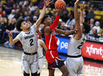 Arizona guard Brandon Randolph, center, drives to the rim for a basket between Colorado guard Daylen Kountz, left, and forward Evan Battey in the first half of an NCAA college basketball game Sunday, Feb. 17, 2019, in Boulder, Colo. (AP Photo/David Zalubowski)