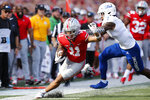 Ohio State receiver Jaxon Smith-Njigba, left, runs out of bounds as Tulsa defensive back TieNeal Martin defends during the first half of an NCAA college football game Saturday, Sept. 18, 2021, in Columbus, Ohio. (AP Photo/Jay LaPrete)