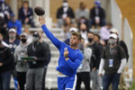 BYU quarterback Zach Wilson throws in the school's pro day  football workout for NFL scouts Friday, March 26, 2021, in Provo, Utah. (AP Photo/Rick Bowmer)