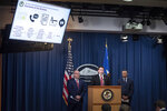 Assistant Attorney General Brian Benczkowski, left, in charge of the criminal division of the Dept. of Justice, U.S. Attorney Robert Duncan, of the Eastern District of Kentucky, center, and FBI Special Agent George Piro, in charge of the FBI's office in Miami, right, appear at a news conference to announce charges against ten former National Football League (NFL) players who are accused of defrauding an NFL health care program, at the Justice Department in Washington, Thursday, Dec. 12, 2019. (AP Photo/Cliff Owen)