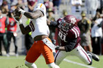 Texas A&M defensive lineman Micheal Clemons (91) grabs the facemark of UTSA quarterback Lowell Narcisse (10) while trying to tackle him during the first half of an NCAA college football game, Saturday, Nov. 2, 2019, in College Station, Texas. (AP Photo/Sam Craft)