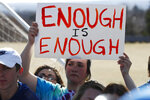 FILE - In this March 14, 2018 file photo, fifteen-year-old Leah Zundel waves a placard during a student walkout to protest gun violence on the soccer field behind Columbine High School in Littleton, Colo. Most of the students who commit deadly school attacks were bullied, had a history of disciplinary trouble and their behavior concerned others, but it wasn't reported. That's according to a comprehensive study by the U.S. Secret Service's National Threat Assessment Center of 41 school attacks since the 1999 Columbine High School Shooting.  (AP Phoot/David Zalubowski)