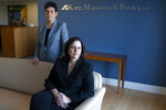 """In this May 21, 2021, photo Washington based civil rights attorneys Debra Katz, left, and Lisa Banks, pose for a portrait at their law firm in Washington. For many people, the pandemic year has brought a pause of some kind, or at least a slowdown, to their professional endeavors. For Katz and Banks, the opposite has been true. """"This is probably the biggest year we've ever had,"""" says Banks.  Their work has been increasing for nearly four years. When the Harvey Weinstein revelations erupted in October 2017,  launching the reckoning that became known as the #MeToo movement, it caused """"a sea change,"""" Katz says. (AP Photo/Jacquelyn Martin)"""