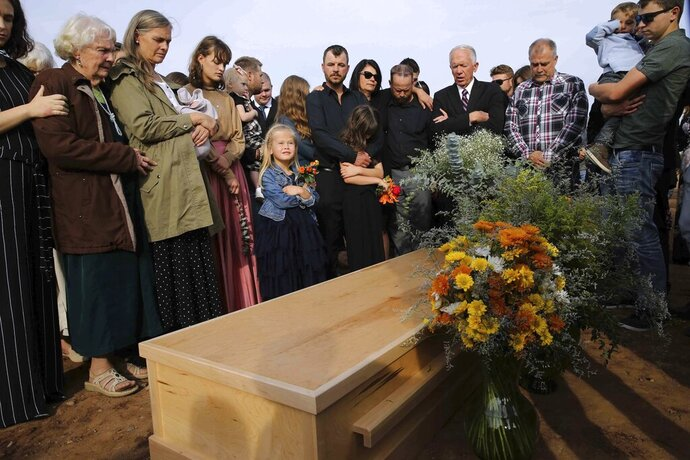 Family and friends attend the burial service of Christina Langford Johnson the last victim of a cartel ambush that killed nine American women and children earlier this week, in Colonia LeBaron, Mexico, Saturday, Nov. 9, 2019. In the attack Monday, Langford Johnson jumped out of her vehicle and waved her hands to show she was no threat to the attackers and was shot twice in the heart, community members say. Her daughter Faith Marie Johnson, 7 months old, was found unharmed in her car seat. (AP Photo/Marco Ugarte)