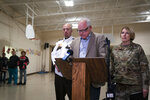 Gov. Tim Walz speaks during a news conference, Thursday, Dec. 5, 2019 in Marty, Minn. At left is Chief Deputy Dan Miller and at right is Brig. Gen. Sandy Best. A Black Hawk helicopter with three crew members aboard crashed Thursday in central Minnesota, the Minnesota National Guard said, though officials did not offer any immediate information about the conditions of crew members. (Renee Jones Schneider/Star Tribune via AP)