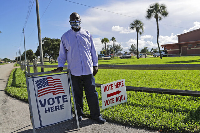 William Freeman, 51, poses for a photograph outside of his polling station, Monday, Aug. 10, 2020, in Riviera Beach, Fla. Freeman recently registered to vote after serving three years for grand theft, his fourth prison stint. (AP Photo/Lynne Sladky)