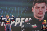 Red Bull driver Max Verstappen of the Netherlands celebrates from the podium after winning during the French Formula One Grand Prix at the Paul Ricard racetrack in Le Castellet, southern France, Sunday, June 20, 2021. (AP Photo/Francois Mori)