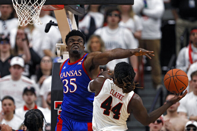 Kansas' Udoka Azubuike (35) blocks a shot by Texas Tech's Chris Clarke (44) during the first half of an NCAA college basketball game Saturday, March 7, 2020, in Lubbock, Texas. (AP Photo/Brad Tollefson)