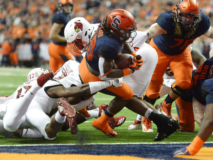 Syracuse running back Jarveon Howard (28) crosses the goal line for Syracuse touchdown against Louisville during the first half of an NCAA college football game in Syracuse, N.Y., Friday, Nov. 9, 2018. (AP Photo/Adrian Kraus)