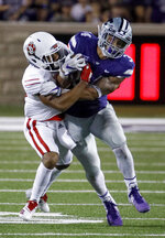 Kansas State running back Alex Barnes is brought down by South Dakota defensive back Cameron Tisdale during the second half of an NCAA college football game Saturday, Sept. 1, 2018, in Manhattan, Kan. Kansas State won 27-24. (AP Photo/Charlie Riedel)