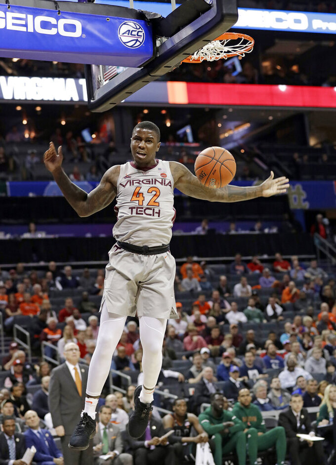 Virginia Tech's Ty Outlaw (42) reacts after a dunk against Miami during the first half of an NCAA college basketball game in the Atlantic Coast Conference tournament in Charlotte, N.C., Wednesday, March 13, 2019. (AP Photo/Chuck Burton)