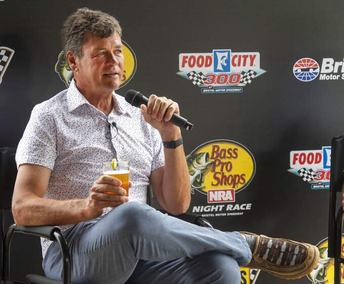 Michael Waltrip talks about the upcoming racing at Bristol Motor Speedway while visiting Michael Waltrip Brewing, Wednesday, Sept. 1, 2021, in Bristol, Va. (David Crigger/Bristol Herald Courier via AP)