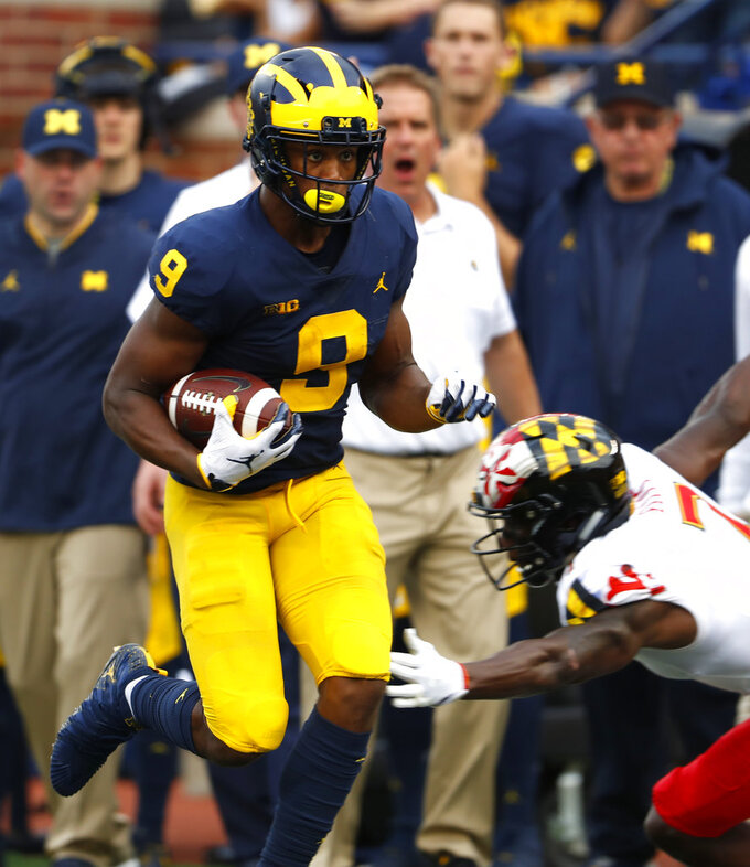 Michigan wide receiver Donovan Peoples-Jones (9) scores on a 34-yard touchdown against Maryland in the second half of an NCAA football game in Ann Arbor, Mich., Saturday, Oct. 6, 2018. (AP Photo/Paul Sancya)