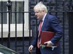 Britain's Prime Minister Boris Johnson leaves 10 Downing Street to attend the weekley session of Prime Ministers Questions in Parliament in London, Wednesday, Jan. 22, 2020. (AP Photo/Kirsty Wigglesworth)