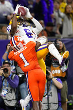 LSU wide receiver Terrace Marshall Jr. catches a touchdown pass over Clemson cornerback Derion Kendrick during the second half of a NCAA College Football Playoff national championship game Monday, Jan. 13, 2020, in New Orleans. (AP Photo/David J. Phillip)