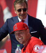 Los Angeles Angels owner Arte Moreno, top, stands next to center fielder Mike Trout during a news conference to talk about Trout's 12-year, $426.5 million contract, prior to the team's exhibition baseball game against the Los Angeles Dodgers Sunday, March 24, 2019, in Anaheim, Calif. (AP Photo/Mark J. Terrill)