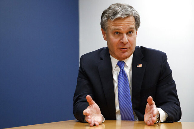 FILE - In this Dec. 9, 2019, file photo, FBI Director Christopher Wray speaks during an interview with The Associated Press in Washington. The FBI said Friday it was taking steps to improve the accuracy and completeness of its wiretap applications for national security investigations and to provide better training for agents. The changes were described in a 30-page filing with the secretive Foreign Intelligence Surveillance Court.  (AP Photo/Jacquelyn Martin, File)